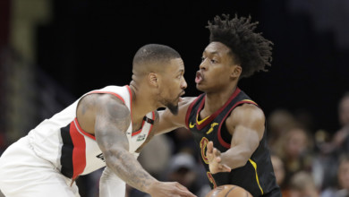 Portland Trail Blazers' Damian Lillard, left, passes against Cleveland Cavaliers' Collin Sexton in the second half of an NBA basketball game, Monday, Feb. 25, 2019, in Cleveland. Portland won 123-110. (AP Photo/Tony Dejak)