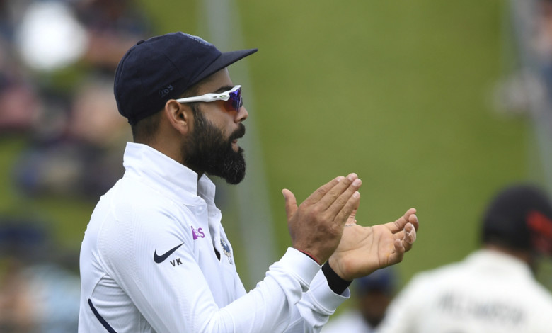 India's Virat Kohli urges his team on against New Zealand during the first cricket test between India and New Zealand at the Basin Reserve in Wellington, New Zealand, Saturday, Feb. 22, 2020. (AP Photo/Ross Setford)