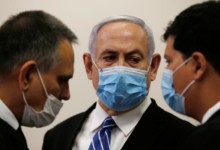Photo of Netanyahu defiant as he arrives for start of trial