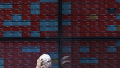 Photo of Shares mostly lower in Asia after retreat on Wall Street