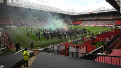 Photo of Manchester United fans mount protest against US owners as match against Liverpool is postponed