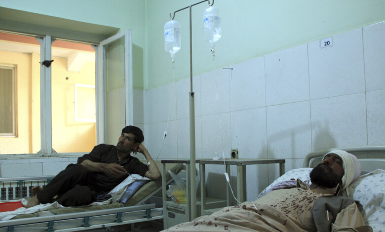 Injured workers of HALO Trust de-mining organization are treated at a hospital in northern Baghlan province, Afghanistan, Wednesday, June 9, 2021. Workers of the organization were attacked on Tuesday night by the armed gunmen. (AP Photo/Mehrab Ibrahimi)